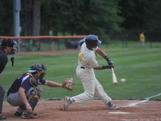 Juan De La Cruz knocks a base hit against the Licking