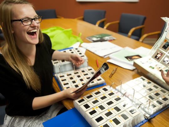 Kerstin Anderson, then 18, laughs while looking through old photos from Lyric Theatre's early productions.