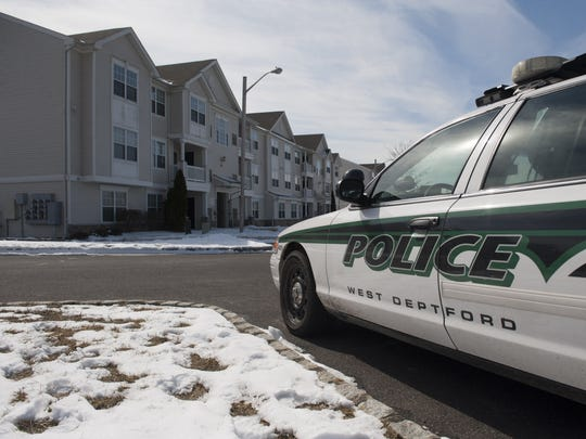 Authorities are investigating the homicide of a 50-year-old West Deptford woman found in her apartment on Highbridge Lane Wednesday night. Thursday, March 6, 2014.