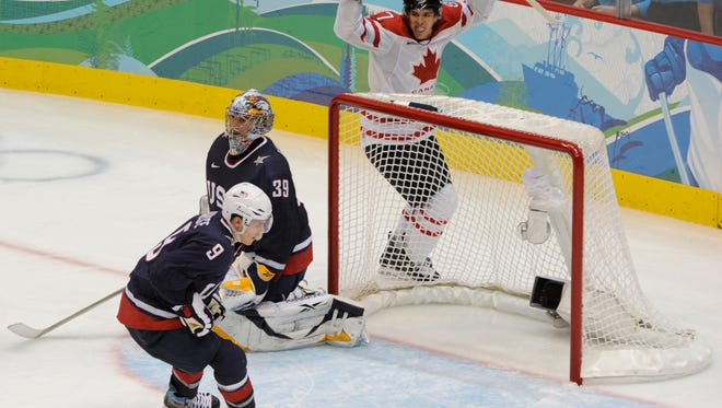 Canada's Sidney Crosby celebrates his overtime goal against the USA's Ryan Miller in the gold medal game at the 2010 Olympics.