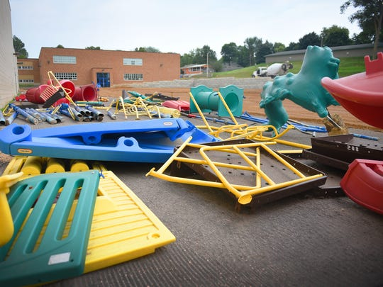 Playground equipment is set aside ready to install at Garfield Elementary School for a new playground Wednesday in Sioux Falls.