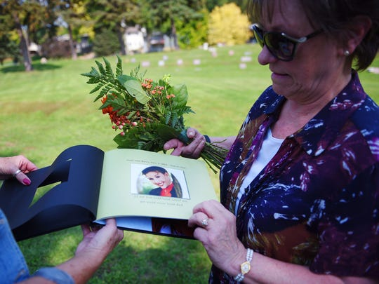 Janine Harris shows a photo album of her daughter Nikki. Jean Healy, Nikki's godmother, helps Janine pick her favorite photo of Nikki. Nikki died in 2005. Since Nikki's suicide, Janine has tried to volunteer with different organizations for suicide prevention.