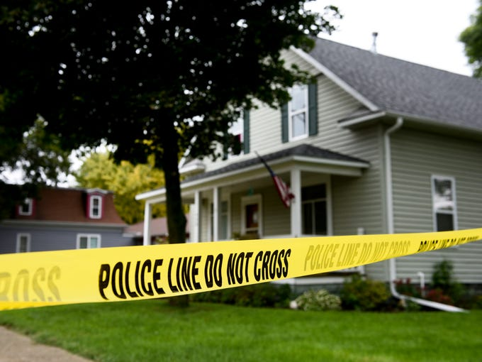 Police tape surrounds the house that was the scene