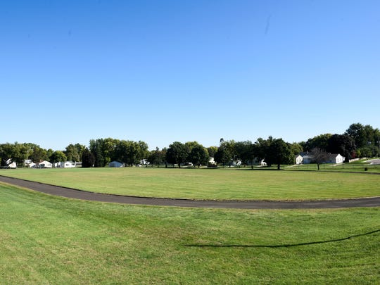 A field and track on the campus of the South Dakota