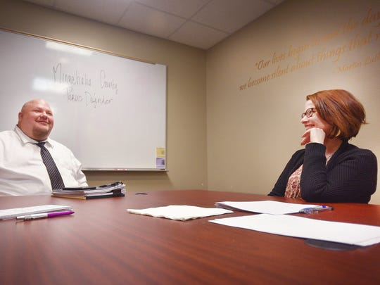 Mike Miller, Chief Deputy Public Defender, and Traci Smith, Minnehaha County Public Defender, talk about increasingly high caseloads Monday, Feb. 26, at the Minnehaha County Public Defender's Office.