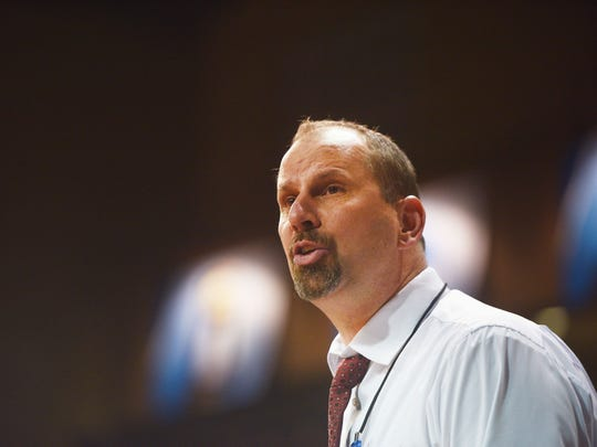Northern State's Paul Sather talks to the team during