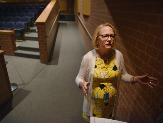 Principal Carrie Aaron walks through Memorial Middle School auditorium Thursday, June 14, in Sioux Falls.