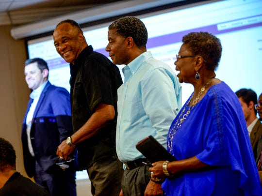 (From left to right) AJ Massey, Morris Merriweather, James Johnson, and Dorothy Black stand up after being announced as new board members at a board meeting at Jackson-Madison County Board of Education in Jackson, Tenn., Thursday, Aug. 9, 2018.