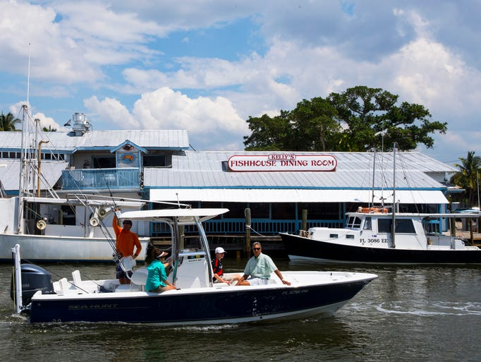 A boat sails past Kelly's Fish House on Monday, April