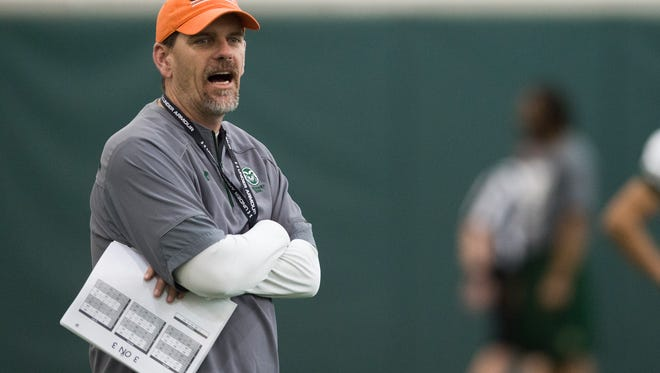 CSU football coach Mike Bobo gives instructions to his team during a practice this spring. Bobo and his staff are hosting the school's annual Ladies Huddle event on May 31.