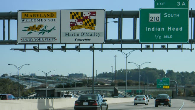 A sign on I-95 north welcomes drivers from Virginia to Maryland. With a new governor being elected Nov. 4, changing the state's highway signage is one of many details that must be attended to.