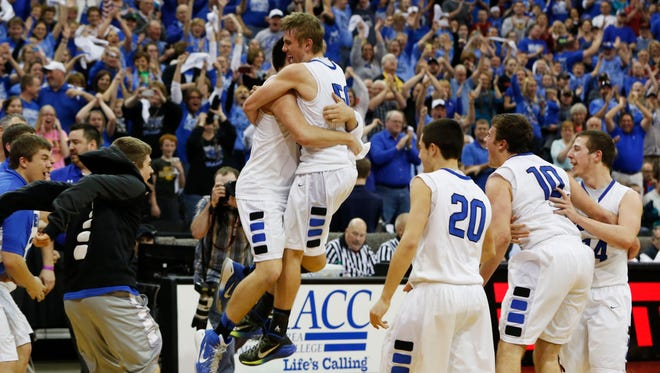 Members of the Gladbrook-Reinbeck basketball team celebrate as time expires Friday in the Class 1-A state boys' basketball tournament championship game. The Rebels defeated Maple Valley/Anthon-Oto 64-52 in their first appearance in Des Moines.