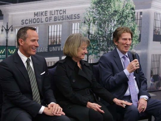 From left, Christopher Ilitch and Marian Ilitch listen as Mike Ilitch speaks during a 2015 press conference announcing their $40 million donation to build the Mike Ilitch School of Business at the McGregor Memorial Conference Center on the Wayne State University campus in Detroit.