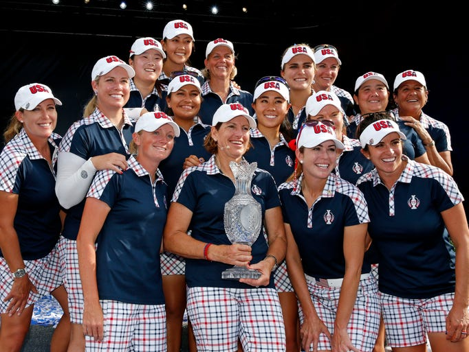 Captain Juli Inkster and the U.S. celebrate their Solheim