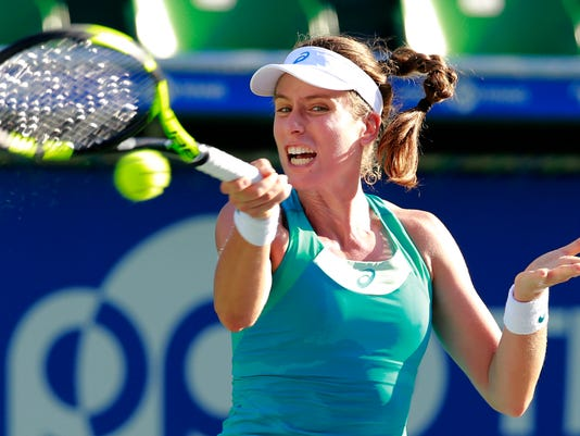 Johanna Konta of Britain returns a shot to Barbora Strycova of the Czech Republic during their second round match of the Pan Pacific Open tennis tournament in Tokyo, Thursday, Sept. 21, 2017. (AP Photo/Shizuo Kambayashi)