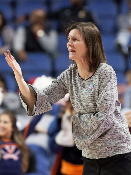 Virginia Head Coach Joanne Boyle gestures to her team during the second half of an NCAA college basketball game against Notre Dame in the Atlantic Coast Conference tournament basketball game in Greensboro, N.C., Friday, March 2, 2018. (AP Photo/Ben McKeown)