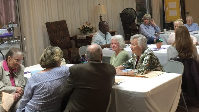 Members of United Presbyterian Church of Binghamton gather together for Dinner Church. The program takes place the fourth Sunday of every month during the summer and allows people to worship informally and enjoy dinner together.