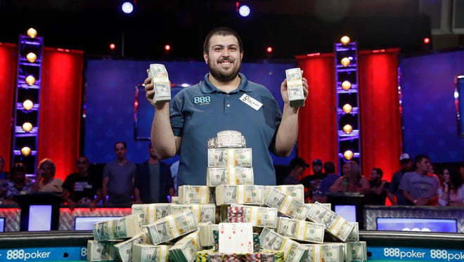 Scott Blumstein poses for photographers after winning the World Series of Poker main event in Las Vegas on Sunday.
