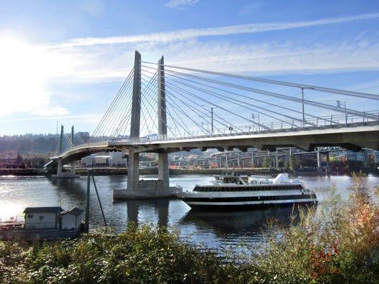 Portland Tilikum Crossing and Portland Spirit cruise ship