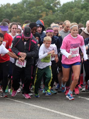 2015: Runners burst from the starting line of the Susan G. Komen Race for the Cure 5k at Six Flags Great Adventure, Sunday, October 4, 2015, in Jackson.