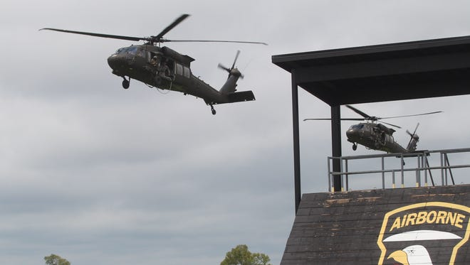 Two Black Hawk helicopters prepare to perform a FRIES/SPIES demonstration in August at the Sabalauski Air Assault School at Fort Campbell.