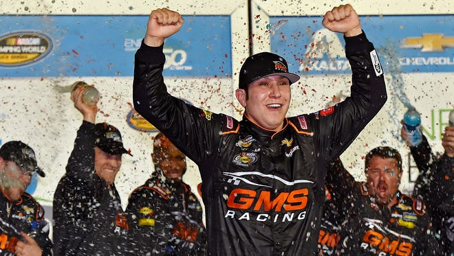 Kaz Grala celebrates winning the NASCAR Camping World Truck Series' NextEra Energy Resources 250 at Daytona International Speedway.