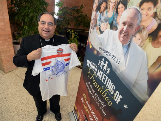 FILE: Bishop Michael Duca of the Diocese of Shreveport shows off a T-shirt inspired by Pope Francis.
