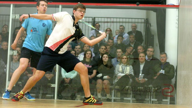 Ned Mylod (foreground), a nationally-ranked junior, made history as the first Birmingham Athletic Club member to participate in the Motor City Open pro squash tournament.