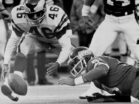 Philadelphia Eagles' Herman Edwards (46) pounced on the ball fumbled by New York Giants quarterback Joe Pisarcik (9) Nov. 19, 1978, during an NFL football game in East Rutherford, N.J. The Eagles won 19-17.