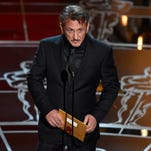 Sean Penn presents the award for best picture at the Oscars on Sunday at the Dolby Theatre in Los Angeles.