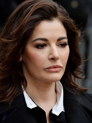 British celebrity chef Nigella Lawson arrives at court in London on Dec. 4, to testify in trial of two former aides accused of fraud.