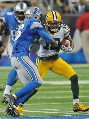 Green Bay Packers wide receiver Randall Cobb (right) makes a catch during a game against the Detroit Lions at Ford Field on Dec. 3.