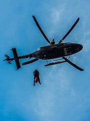 A medic is lowered from an NYPD helicopter onto Anthony's