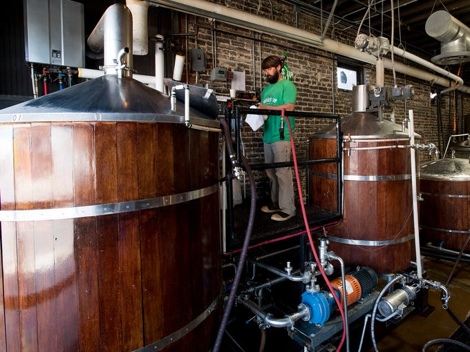 Brewer Matt Risner at work at Avondale Brewing in the