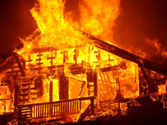 A home  burns in the Thomas Fire in Ventura in the