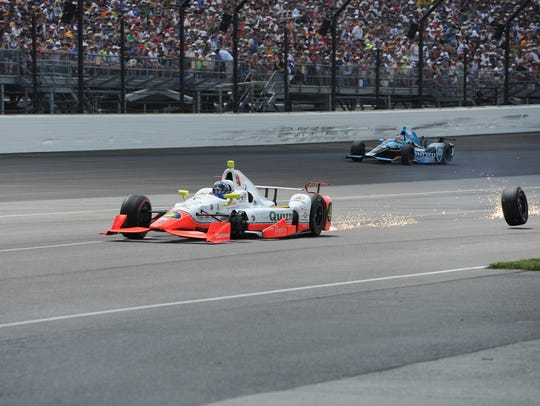 Lazier's car lost a tire  during last year's Indianapolis