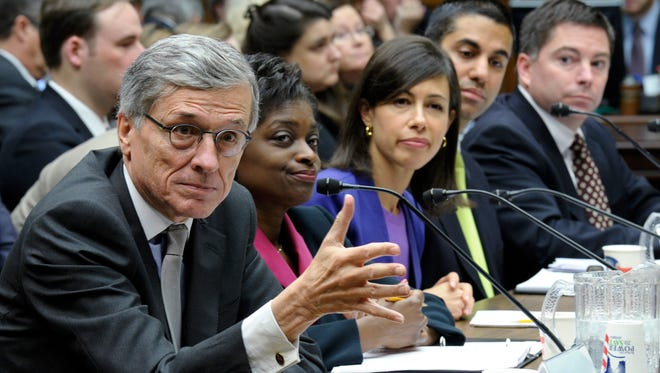 Federal Communications Commission Chairman Tom Wheeler, left, testifies before a House Energy and Commerce subcommittee hearing about cell phones on planes.