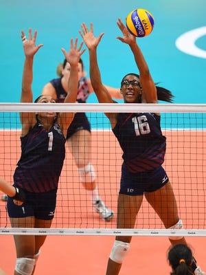 United States setter Alisha Glass, left, and middle blocker Foluke Akinradewo go up for a block against China in a preliminary round Group B volleyball match at Maracanazinho during the Rio 2016 Summer Olympic Games Sunday.