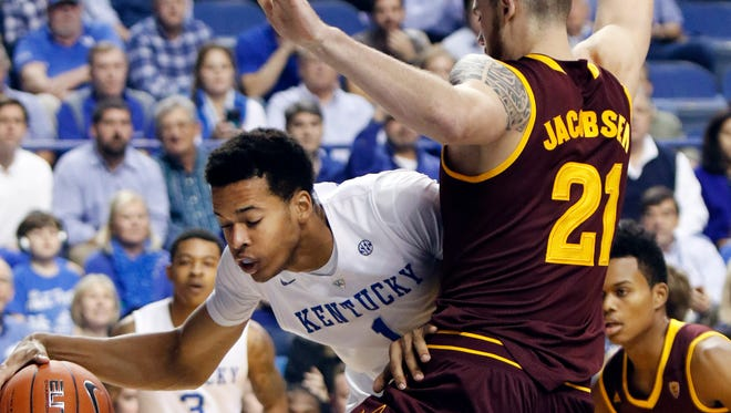 Kentucky's Skal Labissiere, left, looks for an opening on Arizona State's Eric Jacobsen (21) during the first half of an NCAA college basketball game Saturday, Dec. 12, 2015, in Lexington, Ky.  (AP Photo/James Crisp)
