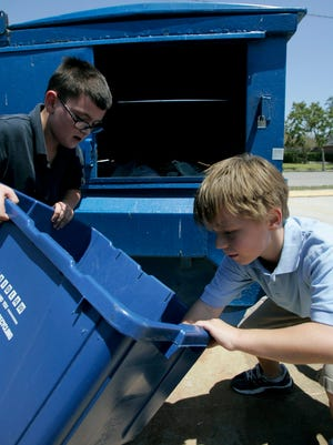 Michael Zamora/Caller-TimesBrandon Dilger, 8 (left), and Jacob Tuley, 7, empty out a small bin of recyclable items into the school's new recycling container Thursday, Aug. 27, 2009 at Montclair Elementary School in Corpus Christi.
