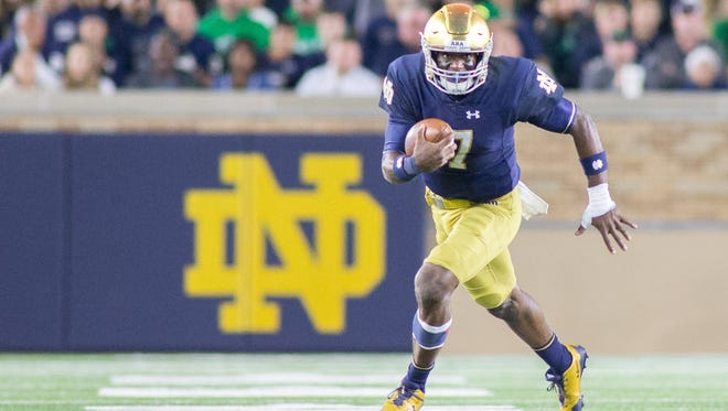 Notre Dame Fighting Irish quarterback Brandon Wimbush (7) runs the ball in the second half of the game against the Miami (Oh) Redhawks at Notre Dame Stadium.