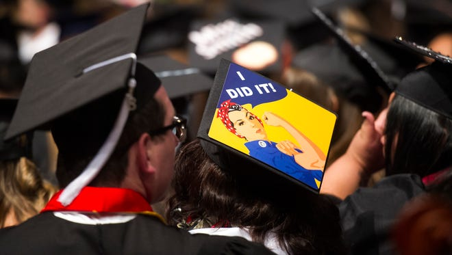 """A Southern Utah University graduate wears a cap reading """"I Did It!"""" during Commencement celebrations at the America First Event Center Friday, May 4, 2018."""