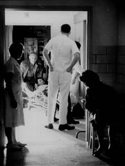 Emergency lights blaze in the Genesee Hospital emergency room as an accident victim is brought in during the blackout in November 1965.