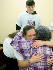 Floyd Zumwalt's granddaughter Cassandra Ward hugs a family member of Craig Miller who was sentence to murder of her grandfather in Kitsap Superior Court in Port Orchard on Tuesday morning.