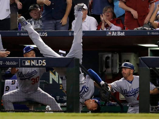Oct 9 Cody Bellinger Falls In The Dugout After Catching