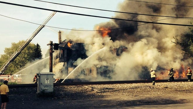 Fire consumes a building on Station Road in East Rochester.