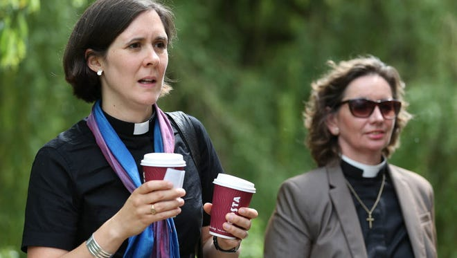 Female members of the clergy join the line to enter the Church of England General Synod in York, northern England, on July 14.