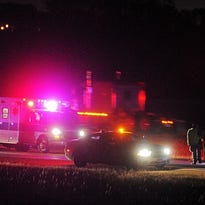 Emergency personnel and law enforcement on scene after reports of a body on Interstate 90 Thursday night, Oct. 1, 2015, in Sioux Falls.