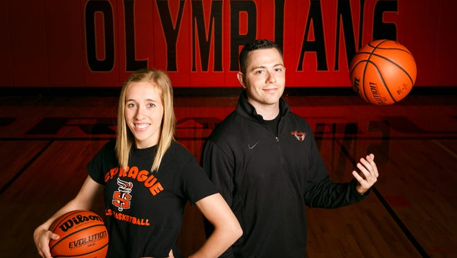 Jordan Graneto, 27, right, is the new boys coach at Sprague and alum Jami Morris, 24, left, is the new girls coach at the school. The two posed for a photo at Sprague High School on Friday, July 13, 2018.