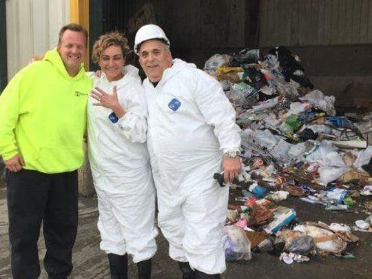 With the help of Meridian Waste Services workers, including operations manager Joe Evans, left, Bernie and Carla Squitieri recovered two rings accidentally thrown in the trash the night before.
